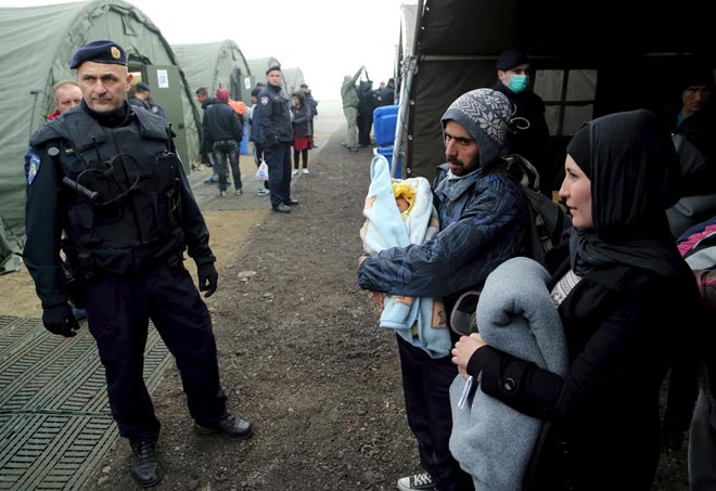 Migrants wait for registration at a new winter refugee camp in Slavonski Brod, Croatia. — Reuters photo