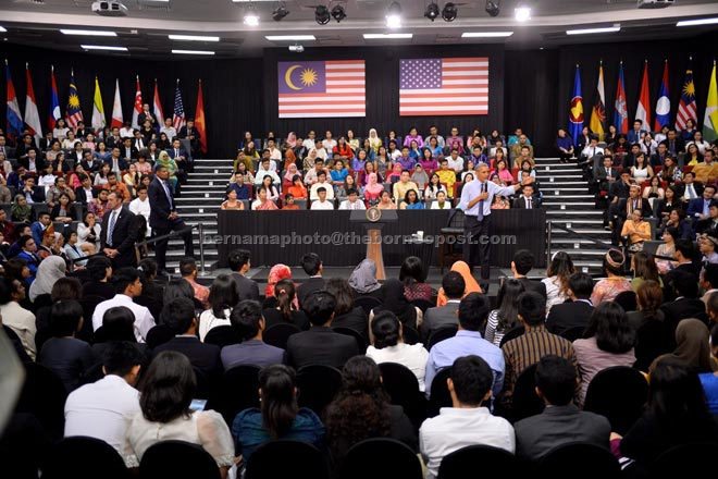 Obama expressing his views at the town hall meeting with alumni of the Young Southeast Asian Leaders Initiative at Taylor's Lakeside University campus. — Bernama photo