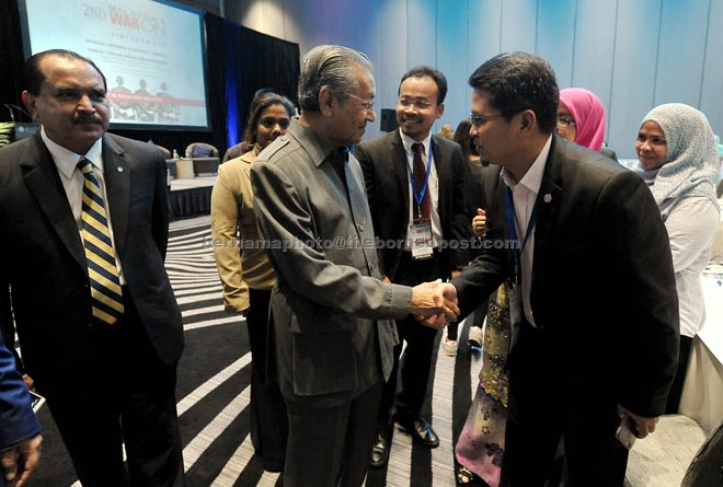Dr Mahathir (second left) being introduced to participants after delivering his keynote address at the 2nd Annual Malaysia's War On Corruption Symposium 'It's Now Or Never'. — Bernama photo