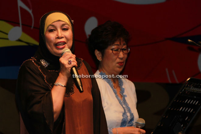 Jamilah (left) lends her voice during a performance with Iwanaga.