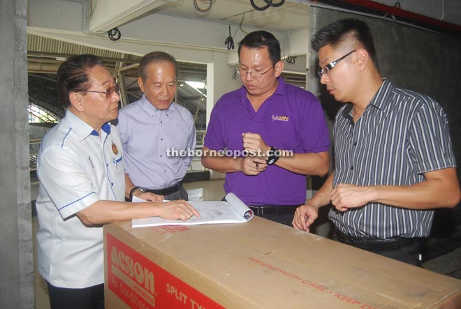 (From left) Wong, Tiong, Tong and Andrew looking at the UTC plan at the site.