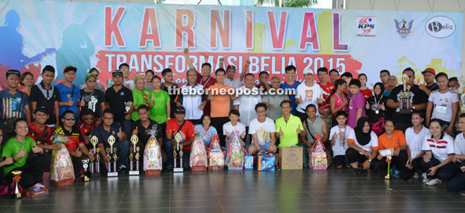 (From ninth left) Sebastian, Hii and others pose with winners of various competitions held in conjunction with the carnival.
