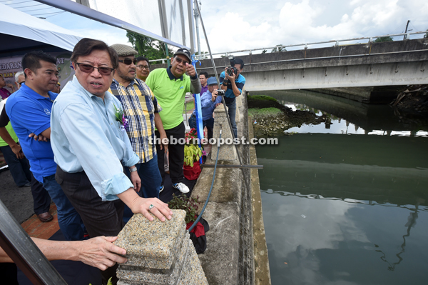 Abang Johari (front) looks across Sungai Bintangor from Kampung Bintangor Waterfront after the launch of 'Jum Berambeh Rah Sungai Bintangor'.