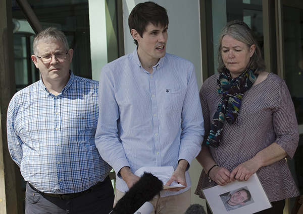Sue Miller (right), Ian Miller (left), and Michael Miller (centre) — the respective mother, father and brother of slain British backpacker David Miller — make a brief statement to the media after the verdict in the murder trial of David Miller, at the Koh Samui Provincial Court in Koh Samui. —  AFP photo