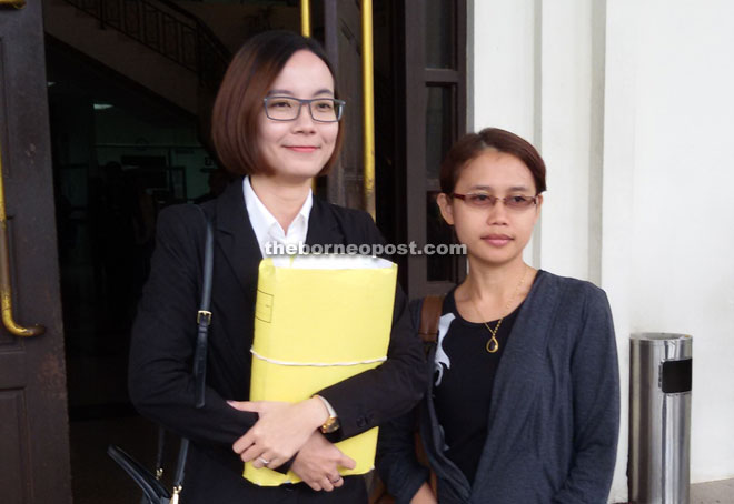 Chua (left) and Azmi @ Roneey's elder sister, Skeeter Joana Gri, after the court hearing.  Skeeter represented her brother to attend the court case.