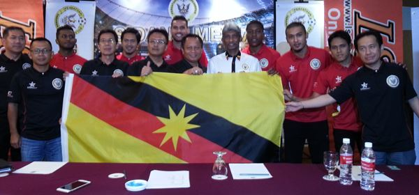 Abu Bakar (centre) with Rajagopal (fifth right) and the newly signed players at the press conference yesterday.