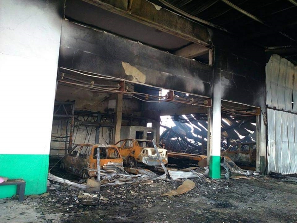 The aftermath of the fire which saw a lorry, motorcycle, cars belonging to workers and a customer totally burnt up in the fire.