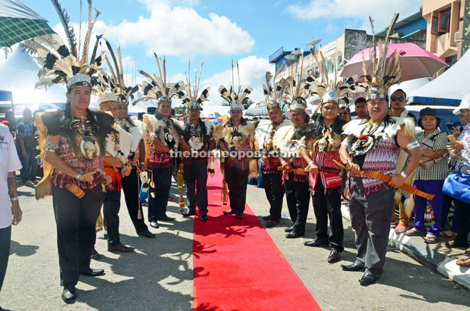 Members of Sarawak Dayak National Union (SDNU) welcome the Chief Minister in traditional Iban costumes.