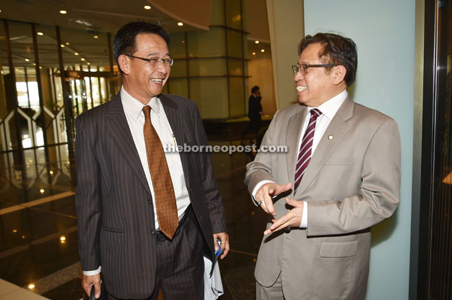 THAT'S HILARIOUS: Assistant Minister of Housing Datuk Abdul Karim Hamzah (left) shares a light moment with Housing Minister Datuk Amar Abang Johari Tun Openg prior to attending the State Legislative Assembly (DUN) sitting yesterday. — Photo by Tan Song Wei