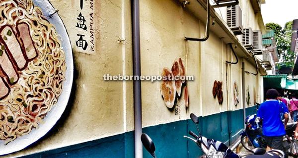 A visual culinary extravaganza that adorns the wall along Market Road lane.