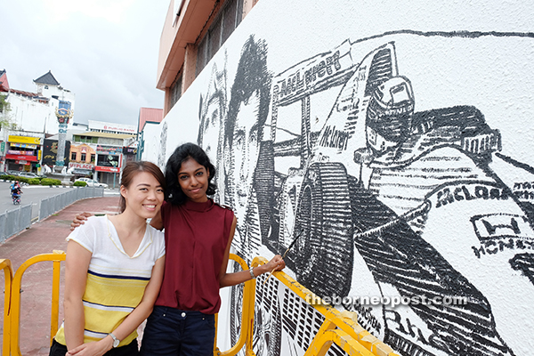 Siaw (left) and Janani have been working on the mural for the past two weeks.