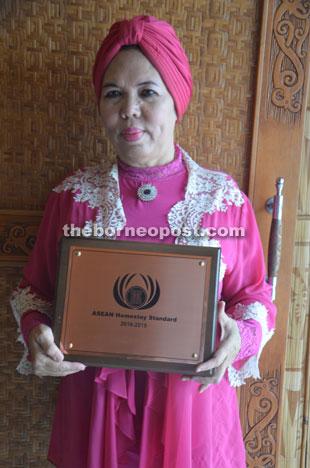 Kampung Santubong Homestay coordinator Jamilah with the Asean Homestay Award.