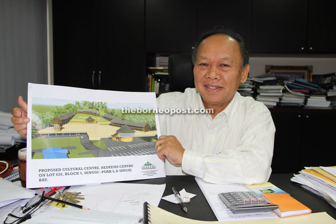 Nansian showing the plan of the RM11-million Bidayuh Cultural Centre which will be launched soon at Redeems Centre, located at Kpg Apar, Singai, Bau.