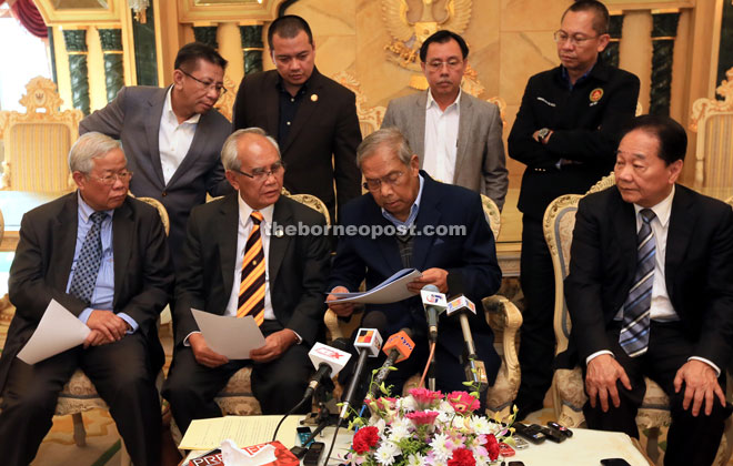 Adenan (seated, second right) reading out the provisions of administrative empowerment to the state government while Jabu (seated second left), Wong (seated right), Manyin (seated left), Dr Rundi (standing second right) and Abdullah (standing right) look on. — Photo by Kong Jun Liung