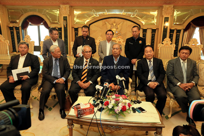 Adenan speaking at the press conference. With him are (seated from left) Morshidi, Manyin, Jabu, Wong, Mawan, Dr Rundi (standing second right) and Abdullah (standing right). — Photo by Kong Jun Liung