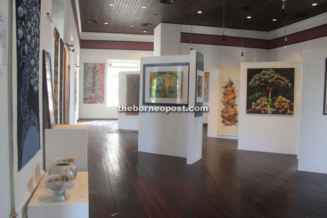 Artwork on display in the spacious gallery area on the upper floor.