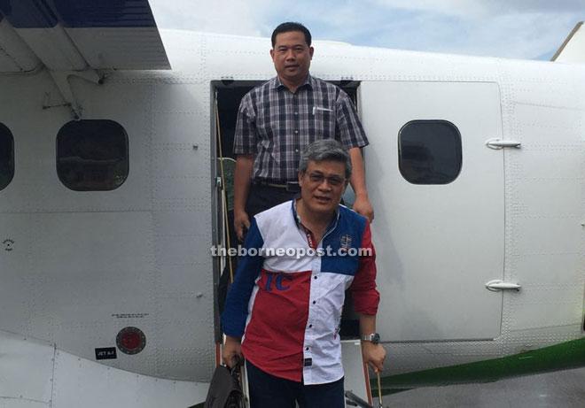 Balang (front) alighting from a Twin Otter aircraft at Lawas Airport.