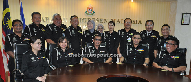 Mohd Zulfikar (seated centre) during a photo call with state immigration officers.