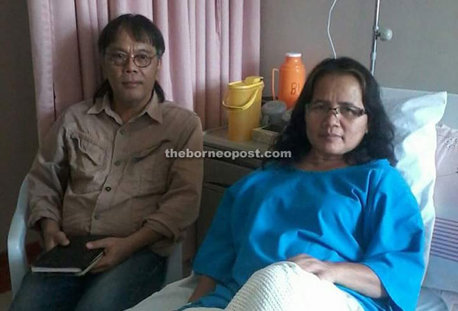 Elli is seen with Idah, who is undergoing treatment in Kuching.