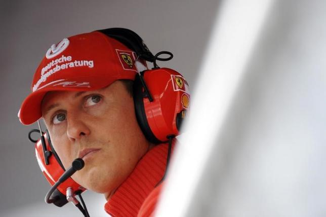 Former Ferrari driver Michael Schumacher of Germany looks on during the qualifying session for the Italian F1 Grand Prix race at the Monza racetrack in Monza, near Milan, in this September 13, 2008 file photo. REUTERS/Alessandro Bianchi