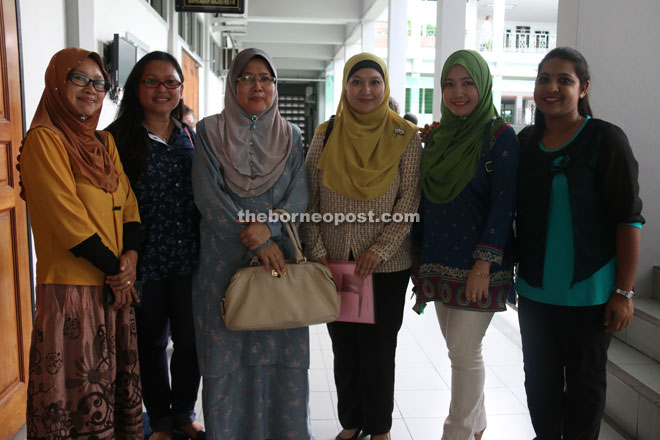 Dr Haliza (fourth left), Yogasri (right) and volunteers from WAO outside the court after the ruling.