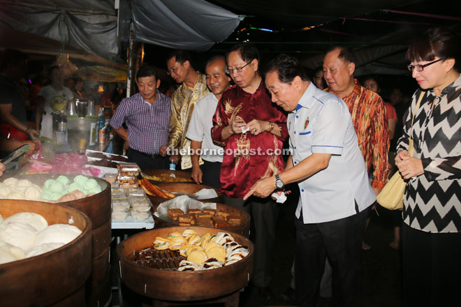 (From fourth left) Lau, Wong and others at a food stall.