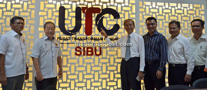 (From left) Bakrie, Wong, Tiong, Morshidi and Ng pose in front of UTC Sibu logo.