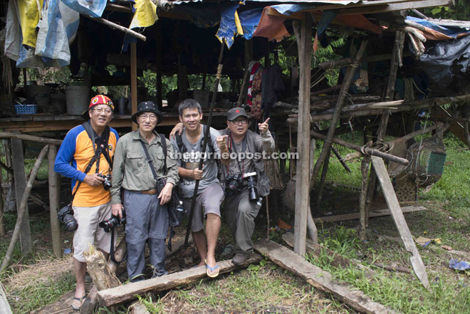 Hon Choon Kim (second left) during one of his numerous trips to Penan villages with his photographer friends.