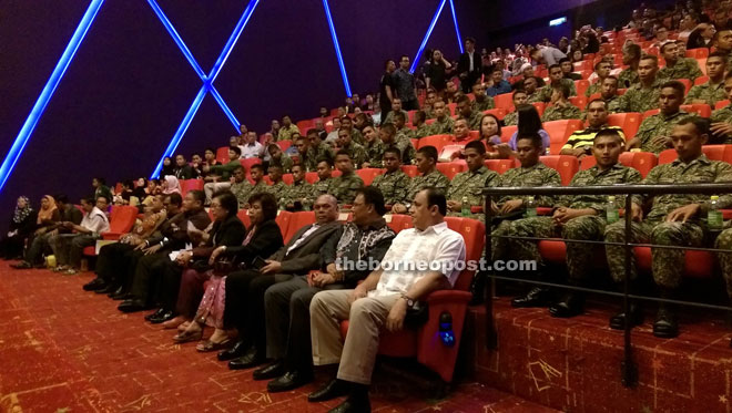 The distinguished guests (front row) watch the special screening of 'Kanang Anak Langkau: The Iban Warrior'.