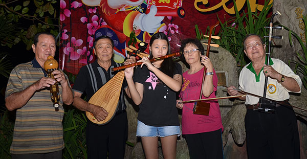 The Chinese classical music group perform nightly at the Tua Pek Kong Temple — Wong (second right) with (from left) Chew Chuong, Audrey, Wong's wife and Nip Sing.