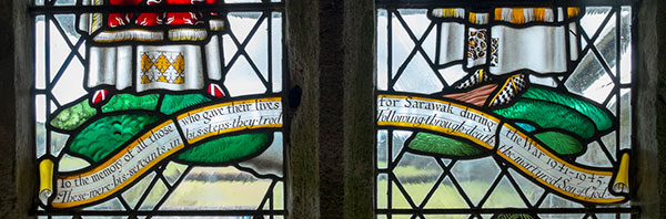 Close up shows the inscription on the stained glass window.