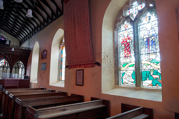 The gifts from Sarawak - stained glass window and pua kumbu - are seen inside St Leonard's Church.