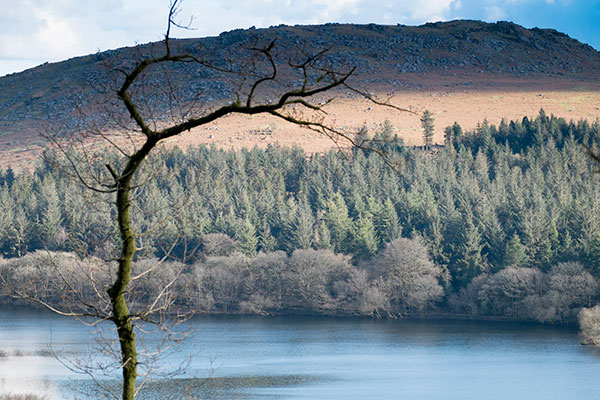 The Burrator reservoir is seen with the granite tor behind it.