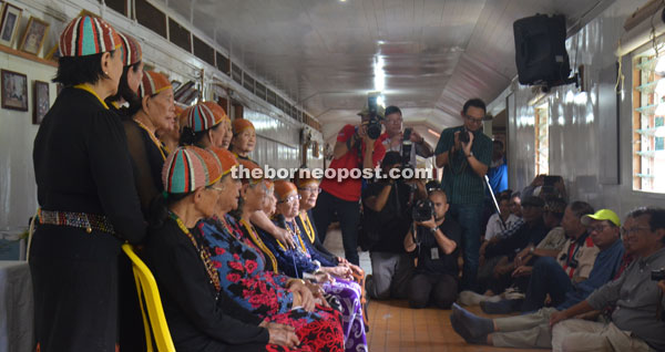 Ahmad Shabery and other visitors being entertained to traditional Kelabit singing during a visit at the Bario Asal longhouse.