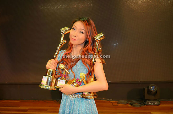 Vivian Liong's four awards won – Best Female Singer, Best Solo Single, Best Female Performer of the Year and Best Composer at VMP Award Ceremony cum Charity Gala Dinner held in Kuala Lumpur recently.