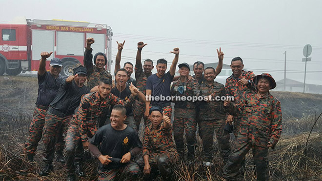 Firefighters who have been battling fires in Papar, were relieved and overjoyed as they cool off in the rain after battling bush and forest fire since the El Nino dry spell.