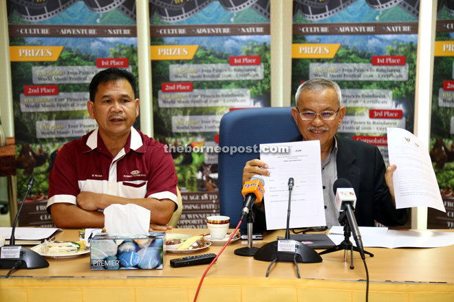 Talib displays the participation form at the press conference. On his right is Ik Pahon Joyik, the permanent secretary of Tourism Ministry.