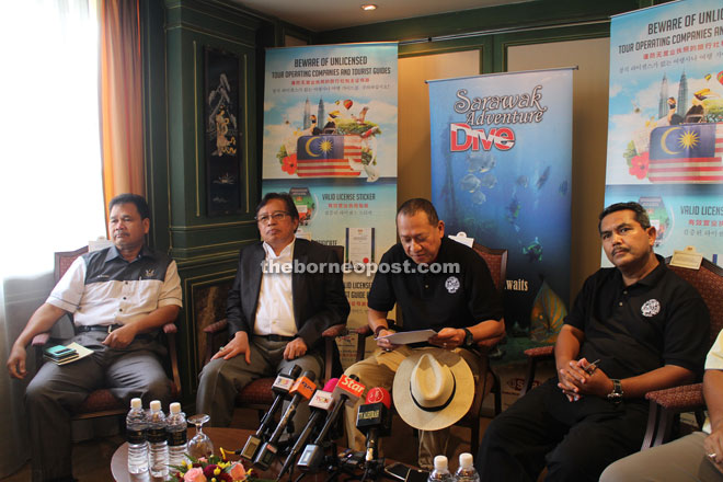 Nazri (second right) and Abang Johari (second left) fielding questions at the press conference after an 'Engagement Session with Sarawak Tourism Industry Players' in Kuching yesterday.