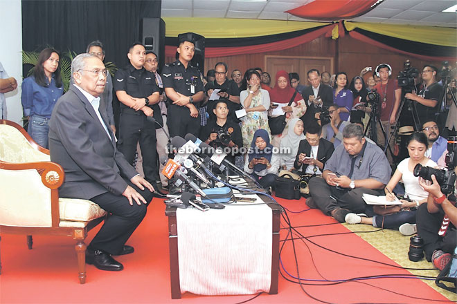 Adenan fields questions from the media.