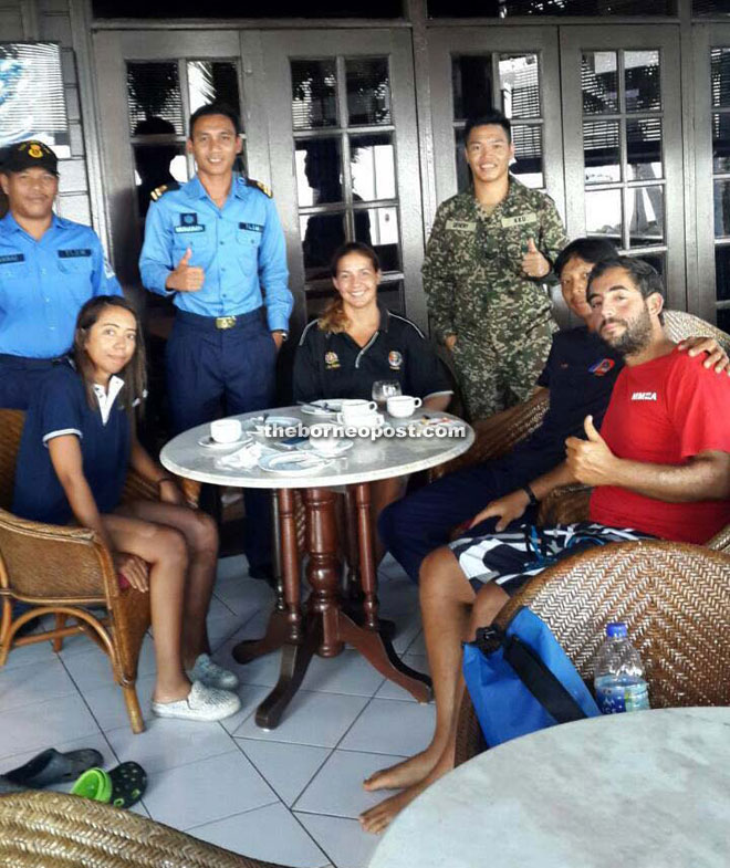 Armella (seated from left), Martha, Tommy and David resting at a resort after arriving at Layang Layang Island on Thursday night.