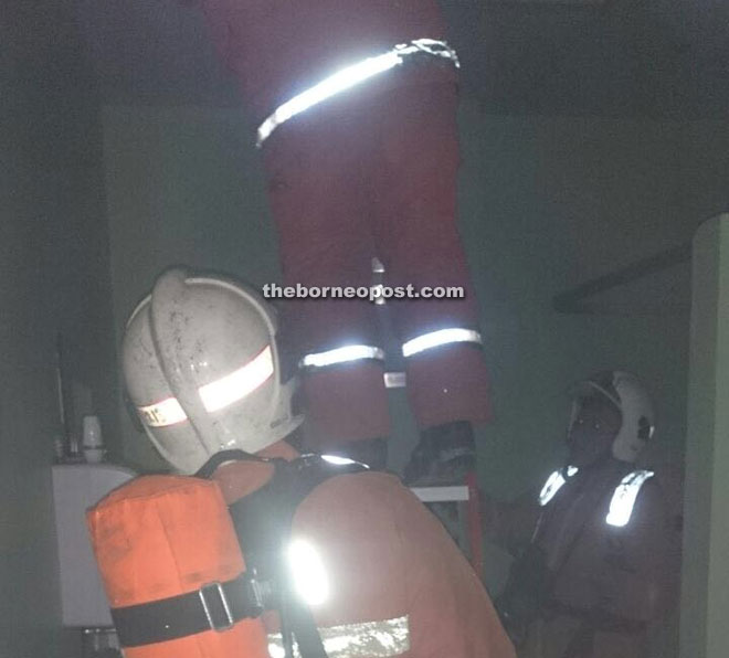 Firefighters from Petra Jaya Fire Station putting out a small blaze when a ceiling light caught fire at Petra Jaya Health Clinic yesterday.