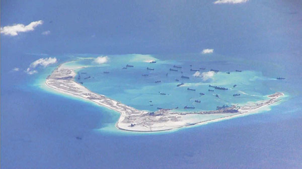 Aerial photo shows a disputed island in the South China Sea. — File photo