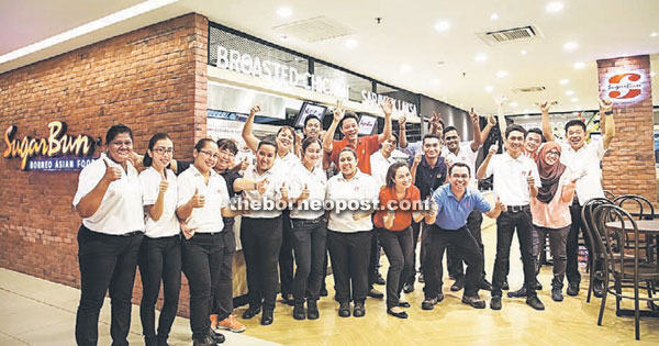 Photo shows staff posing in front of the new SugarBun Borneo Asian Food outlet in Menara Hap Seng, located at the heart of Kuala Lumpur's Central Business District.