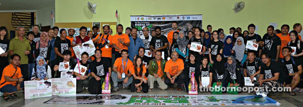 Braken (squatting ninth right) with officials, participants and winners of the 5th International Bornean Frog Race at Lambir Hills National Park.