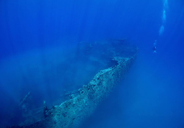 A diver is dwarfed by the giant stern of the wreck in this photo taken April 27, 2014. Divers who visited the wreck last Sunday said that section had been destroyed.