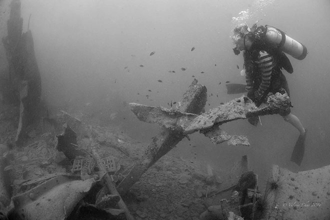 A diver surveys a forlorn landscape of twisted metal structures, debris and rubble – all that is left of the WWII Japanese shipwreck Katori Maru after it was targetted by rogue metal salvag-ers last March.