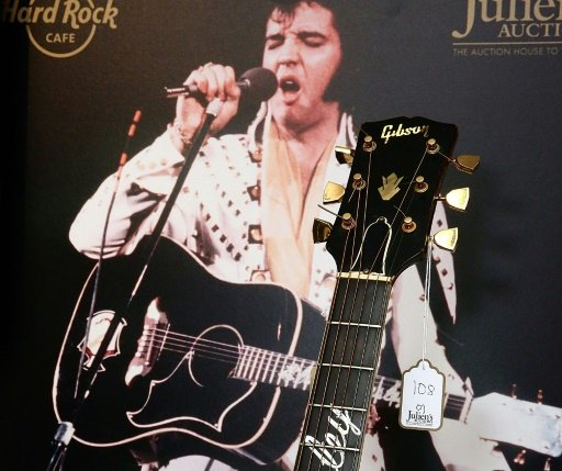 During a 1975 concert in Asheville, North Carolina, Elvis Presley had given the guitar to fan Mike Harris, who had kept it until now. AFP File Photo