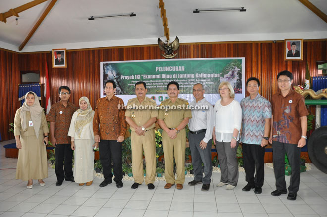 Nasir (fifth left) with his senior officers and senior officers from WWF-Indonesia, WWF-Germany and WWF-Malaysia.