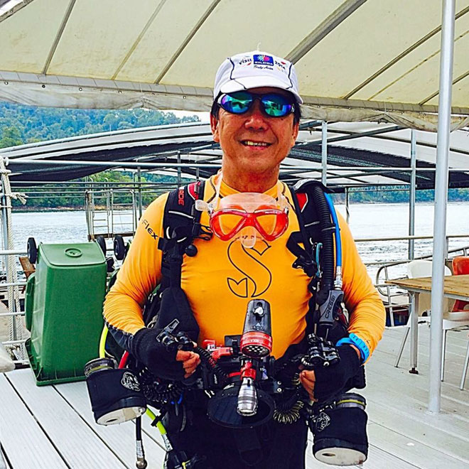 Clement Lee happily back after diving seeing whale shark for three consecutive days.
