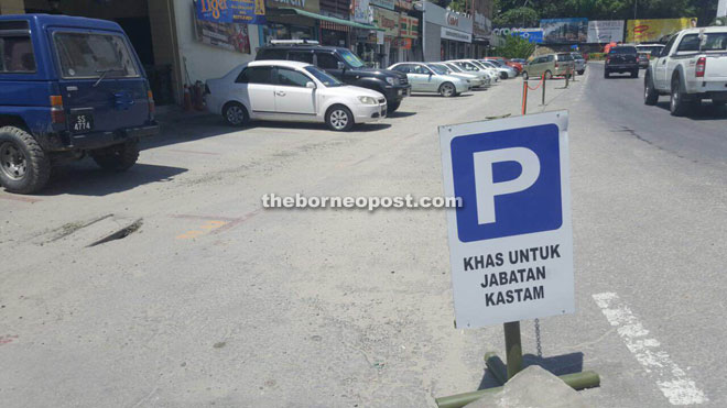 The sign says that this area at Jesselton Point is specifically for the Customs Department.